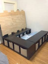 DIY Storage Bed- place three 4-cube storage shelves in a u-shape