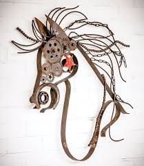 on rustic metal wall sculpture with rustic metal horse with bike chain