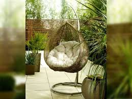 sit comfortably coed in this hanging rattan egg chair with intricate hand woven detail ideal for your garden conservatory or patio
