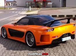 mazda rx7 fast and furious body kit. dengan kit dari mazda rx7 harga yang cukup mahal yaitu sekitar 15000 mobil ini dimodifikasi sedemikian rupa untuk film fast and furious rx7 body