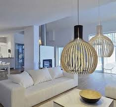 modern living room lighting ideas. Creative Globe Shaped Pendants Lighting Ideas For Modern Living Room Decor With Charming White Loveseat And Square Coffee Table O