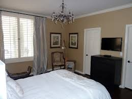 bedroom with tv. Guest Suite With TV Mounted On Wall Over Small Dresser Contemporary-bedroom Bedroom Tv T