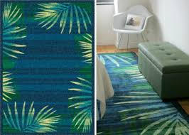 i love palm trees and was looking for a palm leave pattern rug that wasn t too literal wanting it to be more abstract and this is the rug i chose