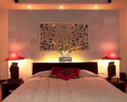 romantic bedroom decorating ideas red laminate ceramic tea pot red varnished wood nightstand red rose