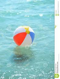 Beach ball in ocean Sand Beach Ball Floating In The Ocean Dreamstimecom Beach Ball Floating In The Ocean Stock Image Image Of Beach