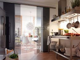 open selves modern kitchen design with sliding glass door and circle breakfast table set with white
