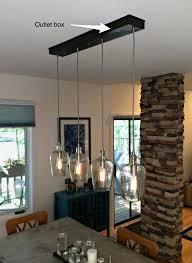 off center chandelier center chandelier over table