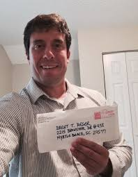 although i am smiling while holding the envelope that contained the decision regarding my case from