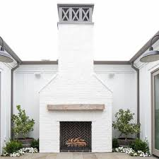 white painted brick with black herringbone brick in firebox