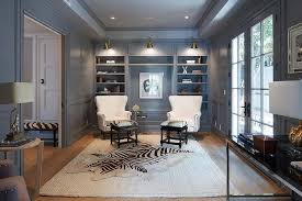 gray den with layered rugs