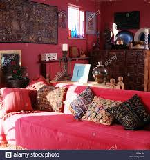 Indian Style Living Room Furniture Embroidered Indian Cushions On Sofa With Red Throw In Red Stock