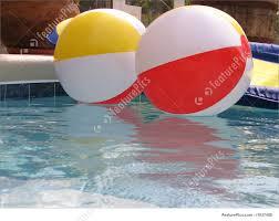 swimming pool beach ball background. Shot Of Two Beach Balls And A Lounge In Pool. Swimming Pool Ball Background