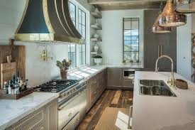 gray wash kitchen cabinets and drawers with gold trim