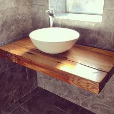 Our floating bathroom shelf with vessel bowl sink. handcrafted wood,  reclaimed railway sleepers from