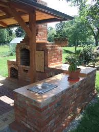 picture of diy outdoor fireplace with bbq grill brick