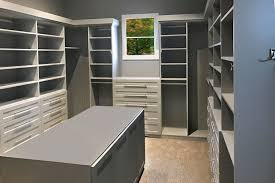 walk in closet with closet island and window hutch