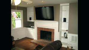 hanging tv over fireplace mounting a over fireplace hang over fireplace where to put cable box hanging tv over fireplace ideas