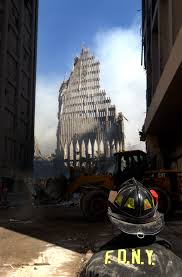 u s government response to the attacks   13 2001 a new york city firefighter looks up at what remains of the south tower