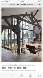 Visit of an industrial loft in Paris, huge glass in the living room  overlooking the terrace