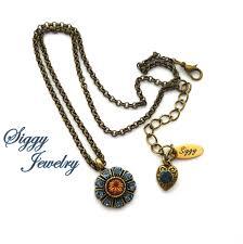 swarovski crystal flower cer pendant denim blue and light smoked topaz dark amber antique brass chain