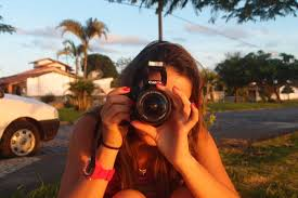 Image result for woman taking cell phone pic of someone else