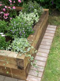 this is another version of a raised planter box using sleeper timbers this tutorial is mostly a photo tutorial but it does have a supply list and a