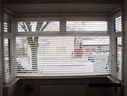 Bay Window Shades Ideas Romanow Treatmentslinds White Venetian Bay Window Vertical Blinds
