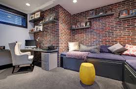 View in gallery Contemporary basement home office with a brick wall