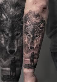 фото тату на руке волк