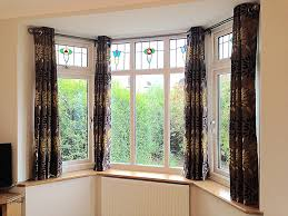 bay windows with stained glass bespoke curtains blinds