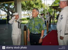 Hawaiian Governor David Ige is saluted upon his arrival at the