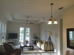 space that demands a 52 or bigger fan i think but the chandelier is too close to the wall for a fan that large any suggestions thanks so much