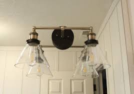brass lighting for mirror in bathroom