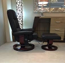 massage chair and footstool. nice faux leather massage/heat swivel recliner chair / footstool black massage and