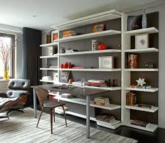 open space home office. a wall of open shelving creates an organized space for books and small items that typically result in clutter legacy park home decor ideas office s