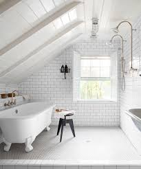 view full size attic bathroom features sloped paneled ceiling
