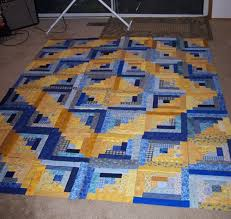 Aqua Reef Studios   the Quilt or Stitch Blog: Another Log Cabin ... & Also, I got all of the squares cut out for the trip around the world for my  cousin. I am doing it on the fusible gridding, so I've divided the quilt up  ... Adamdwight.com