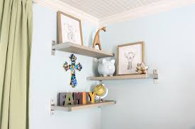 shelves installed in baby boy blue room