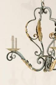 french five light painted iron chandelier featuring lovely acanthus leaf motifs in good condition for