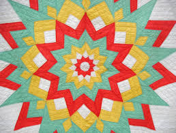 11 Point Starburst Quilt from Sharon's Antiques & Using all solid colors, red-orange, yellow, nile green and white, the  quilter has assembled a series of stars, each surrounding another within,  ... Adamdwight.com