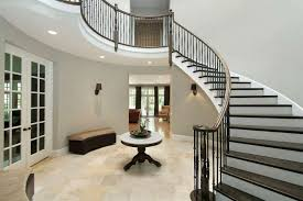 foyer with curved wrought iron stairs
