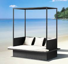 Exterior:Dazzling Outdoor Lounge Bed In Beach With Black Wicker Floating Bed  And Square White