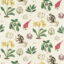 capuchins fabric a woven fabric featuring large prints of capuchin monkeys parrots pink flowers with green foliage and pomegranates on a beige background