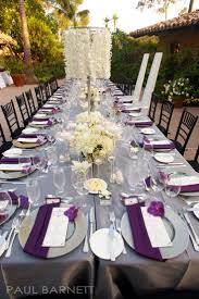 Extravagant tablescape of white, purple and grey - love the napkin fold  over the plate
