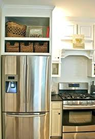 kitchen cabinets around refrigerator cabinets above refrigerator kitchen cabinets around refrigerator kitchens can i remove one