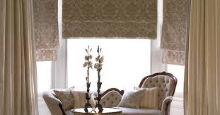 luxury living room design with venetian blinds plus tufted sofa and curtains