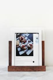 diy wood tablet or ipad stand i love how simple and beautiful this ipad or tablet stand made by the artful desperado is you ll just need a few pieces of