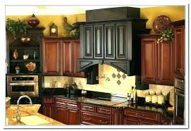 decorating above kitchen cabinets. Decorating Above Kitchen Cabinets With Greenery . H