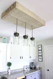 i love that i was able to create an easy budget friendly light fixture that solved so many issues no more dark dreary kitchen lots of light over our