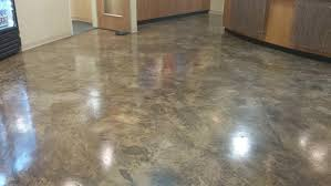 we start preparing your floor for maximum epoxy coating adhesion with a dust free industrial power grinder which removes all previous coatings and stains